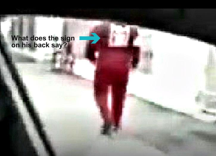 Man in red outside Al Noor